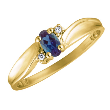 Created Alexandrite 5x3 oval (June birthstone) set in 10kt yellow gold ring w...