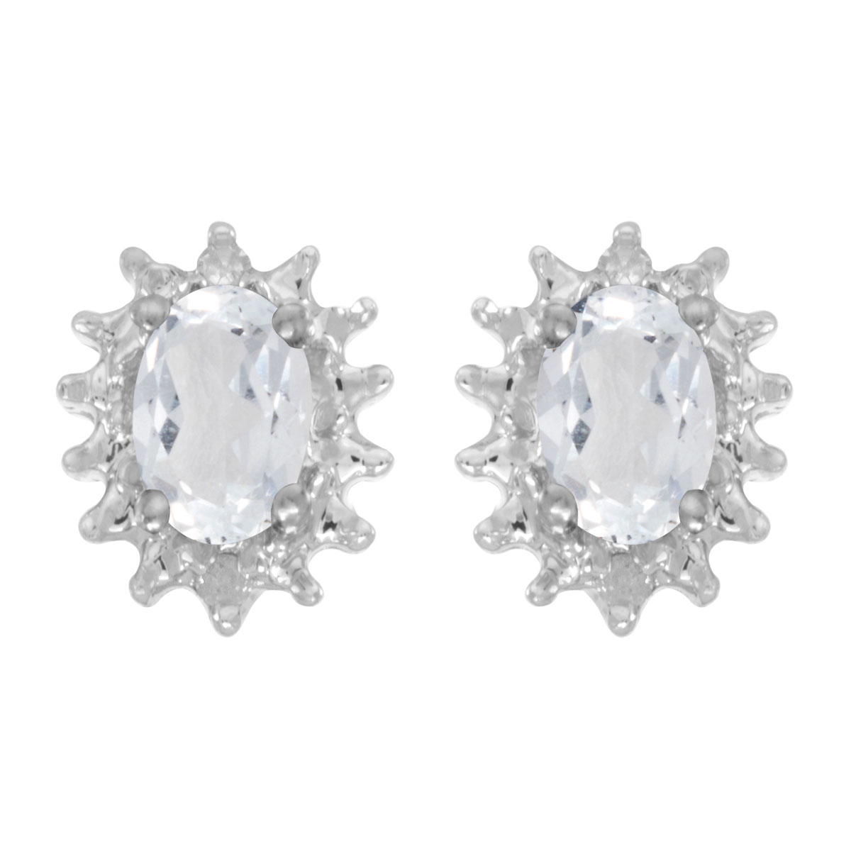 These 14k white gold oval white topaz and diamond earrings feature 6x4 mm genuine natural white topazs with a 0.96 ct total weight and .04 ct diamonds.