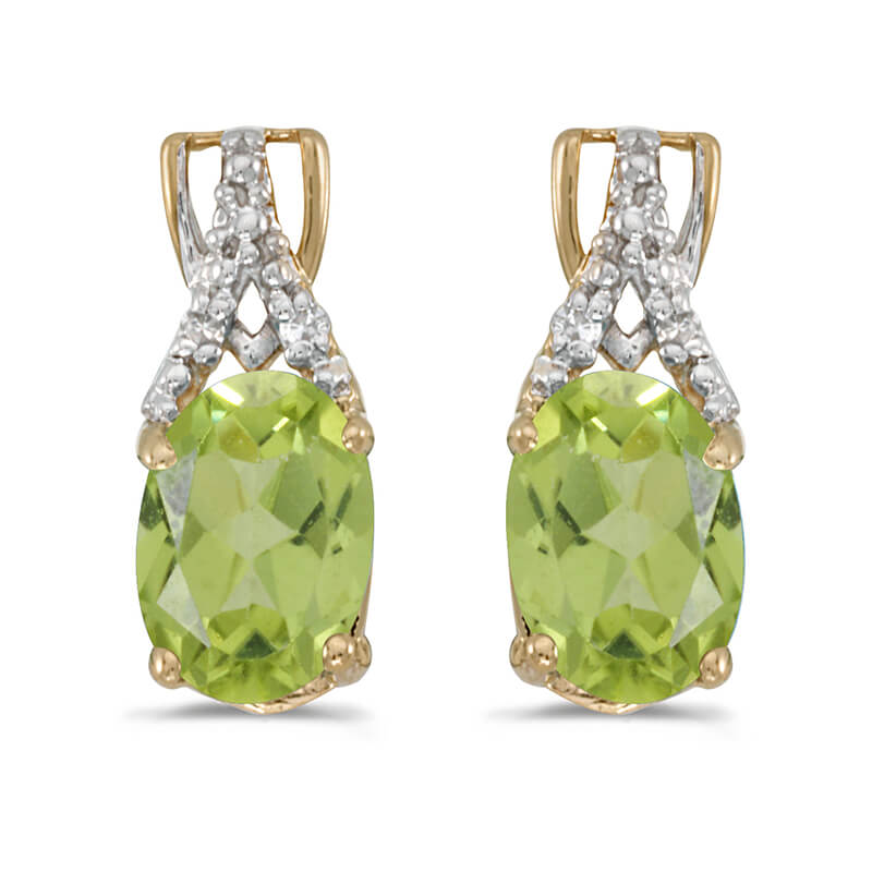 These 14k yellow gold oval peridot and diamond earrings feature 7x5 mm genuine natural peridots with a 1.34 ct total weight and sparkling diamond accents.