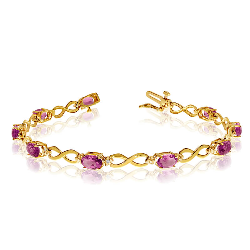This 10k yellow gold oval pink topaz and diamond bracelet features nine 6x4 mm stunning natural pink topaz stones with a 3.87 ct total gem weight.