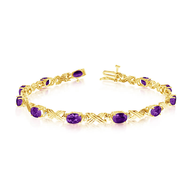 This 14k yellow gold oval amethyst and diamond bracelet features eleven 6x4 mm stunning natural amethyst stones with a 3.74 ct total gem weight.