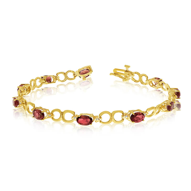 This 14k yellow gold oval garnet and diamond bracelet features ten 6x4 mm stunning natural garnet stones with a 4.70 ct total gem weight.