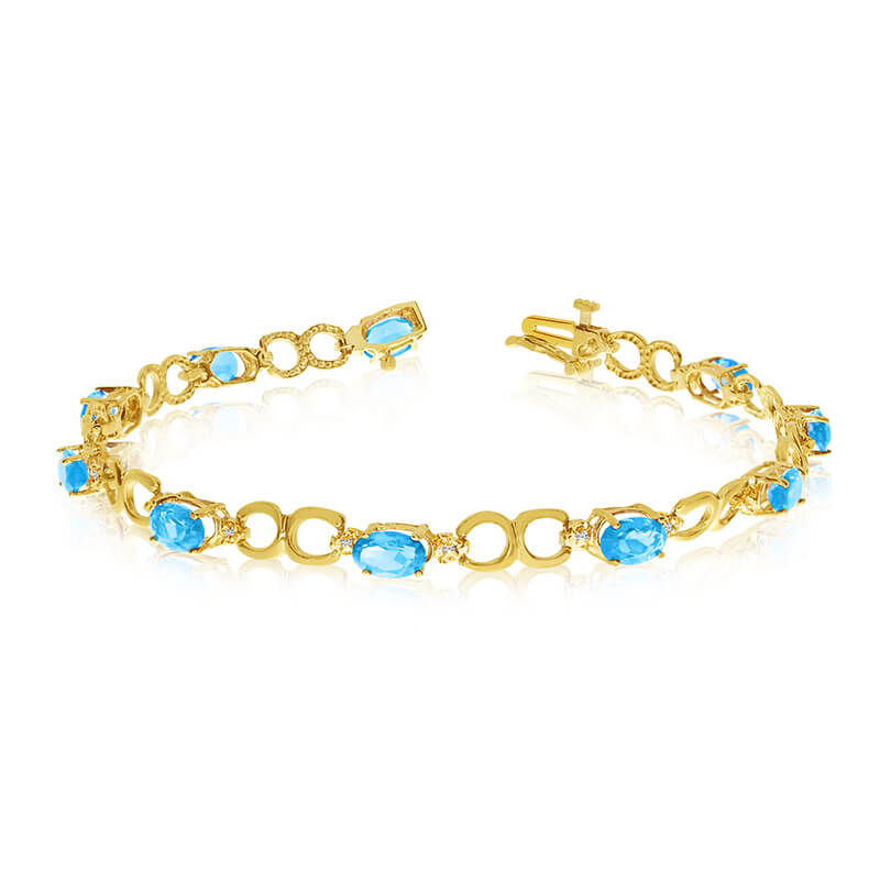 This 14k yellow gold oval blue topaz and diamond bracelet features ten 6x4 mm stunning natural blue topaz stones with a 4.00 ct total gem weight.