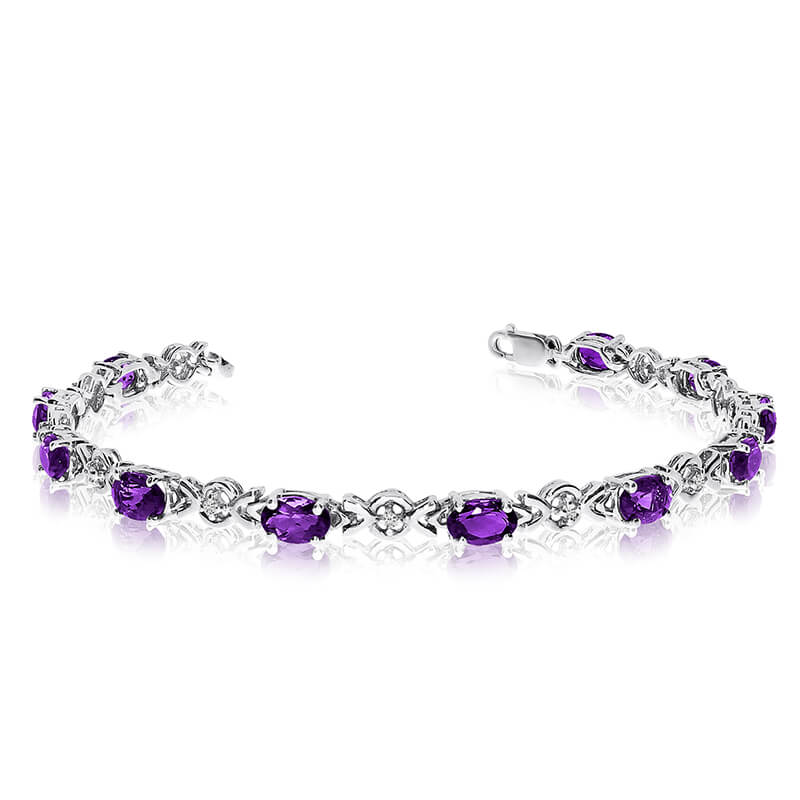 This 10k white gold oval amethyst and diamond bracelet features eleven 6x4 mm stunning natural amethyst stones with a 3.74 ct total gem weight.