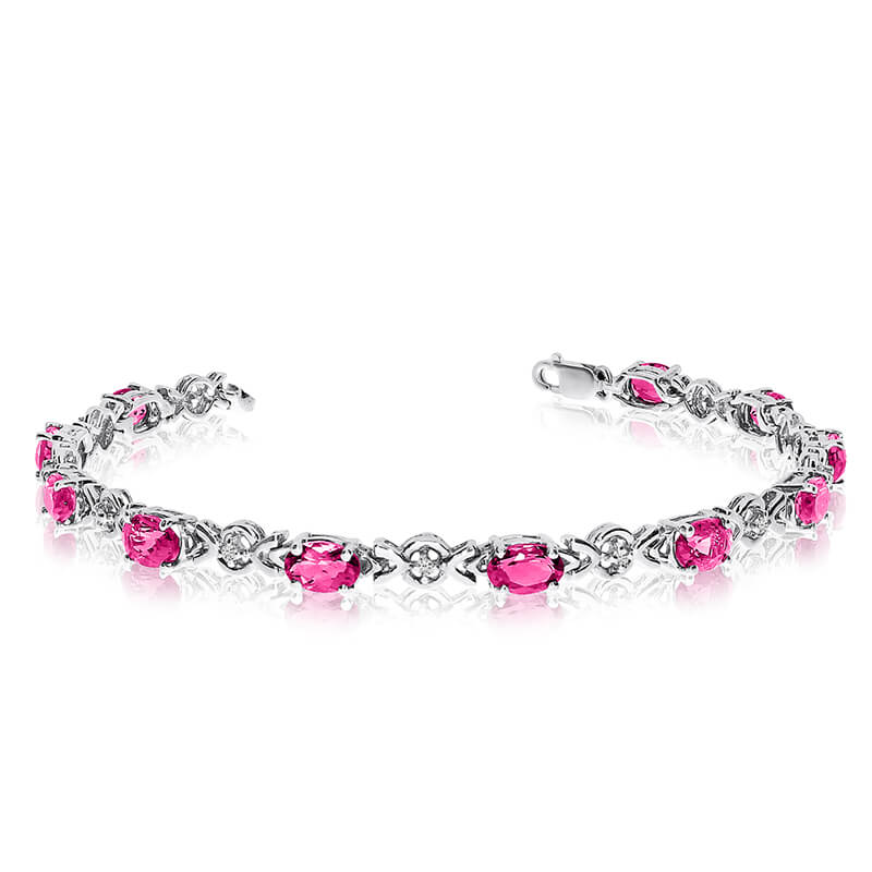This 14k white gold oval pink topaz and diamond bracelet features eleven 6x4 mm stunning natural pink topaz stones with a 4.73 ct total gem weight.