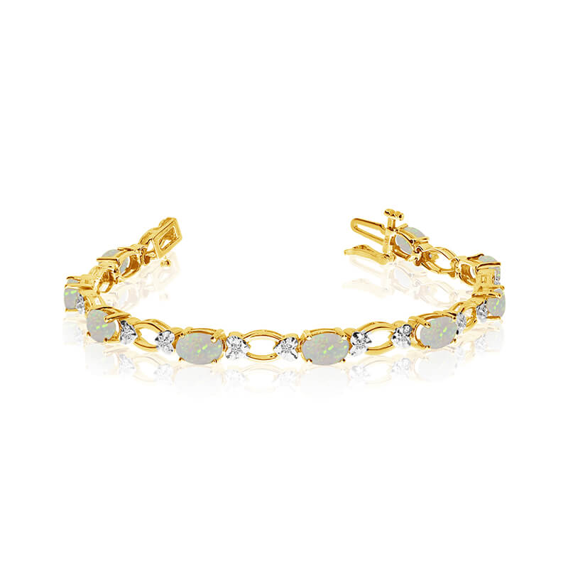 This 14k yellow gold natural opal and diamond tennis bracelet features 12 oval opals with a total gem weight of 2.28 carats and a total diamond weight of 0.12 carats.