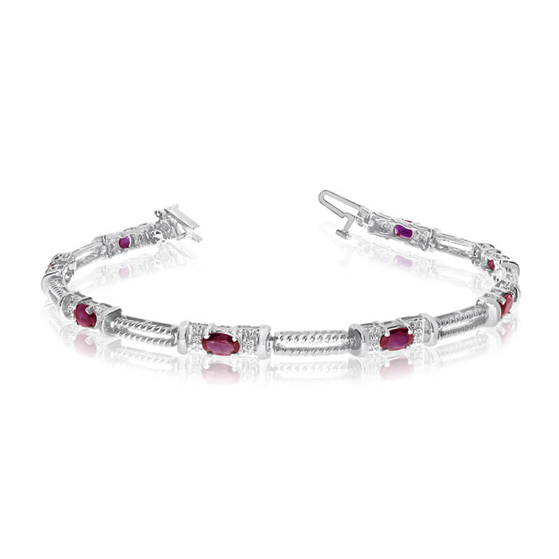 This 14k white gold natural ruby and diamond tennis bracelet features 8 oval rubys with a total g...