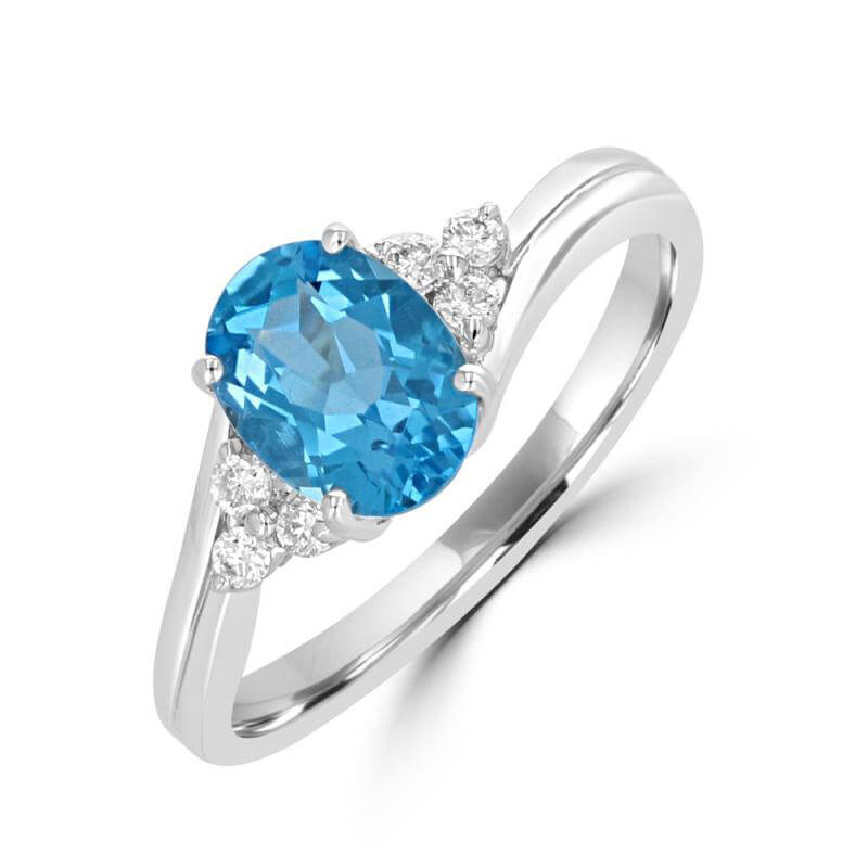 6X8 OVAL BLUE TOPAZ AND THREE DIAMONDS ON EACH SIDE RING