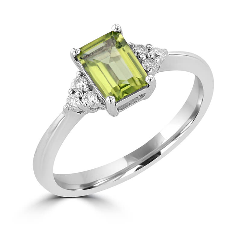 5X7 EMERALD CUT PERIDOT WITH THREE DIAMONDS EACH SIDE RING