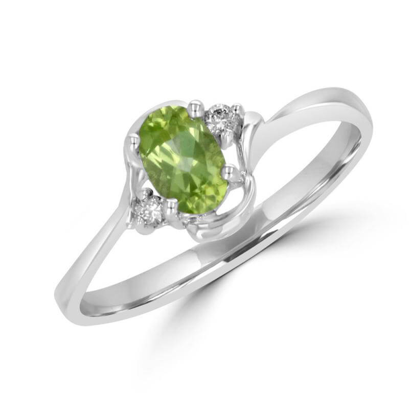 4X6 OVAL PERIDOT AND ONE DIAMOND EACH SIDE RING