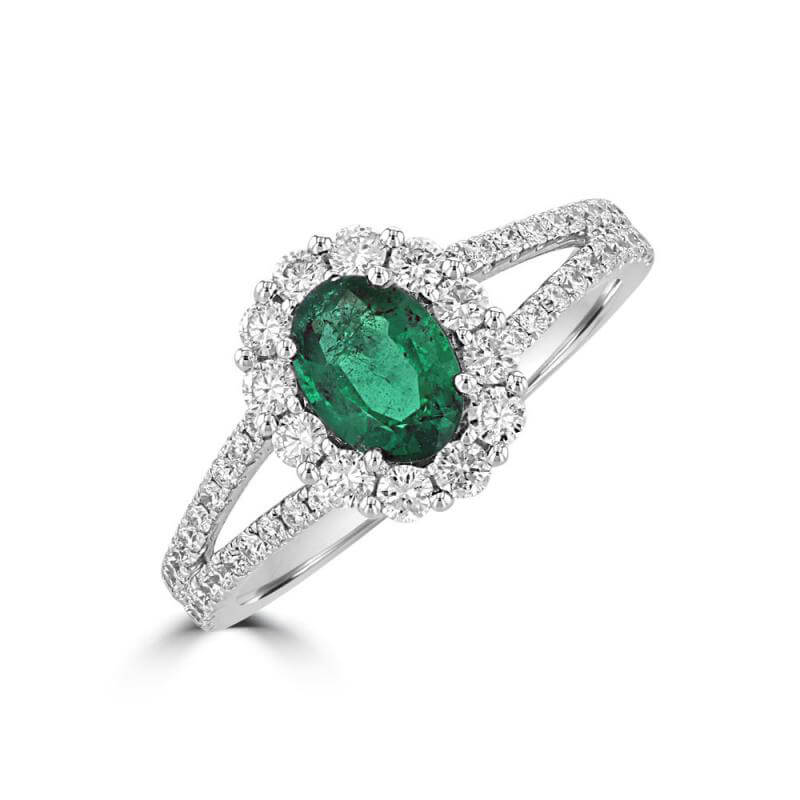 OVAL EMERALD HALO AND DIAMONDS ON SHANK RING